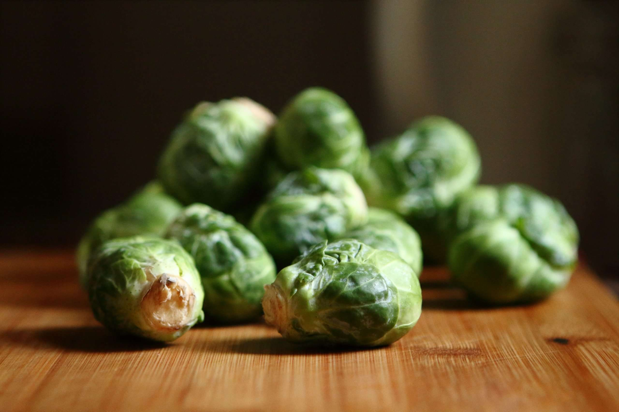 Close up of Brussel Sprouts on a wooden table
